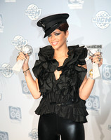 rihanna holding her awards at the much music video awards mmva toronto