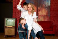 mom with her 2 sons in a family portrait on swing at phat dog visuals studio