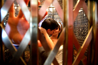 bride and groom kissing with hand up in retro elevator at gladstone  hotel