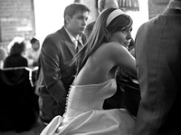candid black and white photograph of bride and groom sitting at the bar at the gladstone  hotel toronto canada