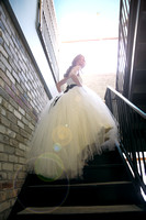bride climbing stairs while looking back over her shoulder and laughing while wearing vera wang wedding dress