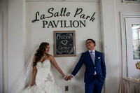 bride and groom holding hands under chalkboard  at lasalle park in burlington ontario canada