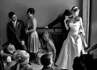 black and white wedding photo of bridal party in the stairwell at the drake hotel in toronto as bride looks out the window