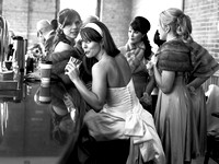 candid black and white photo of bride drinking from a straw at the bar at the gladstone hotel in toronto canada