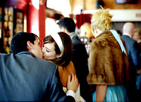 bride and groom kissing at the bar at the gladstone hotel in toronto